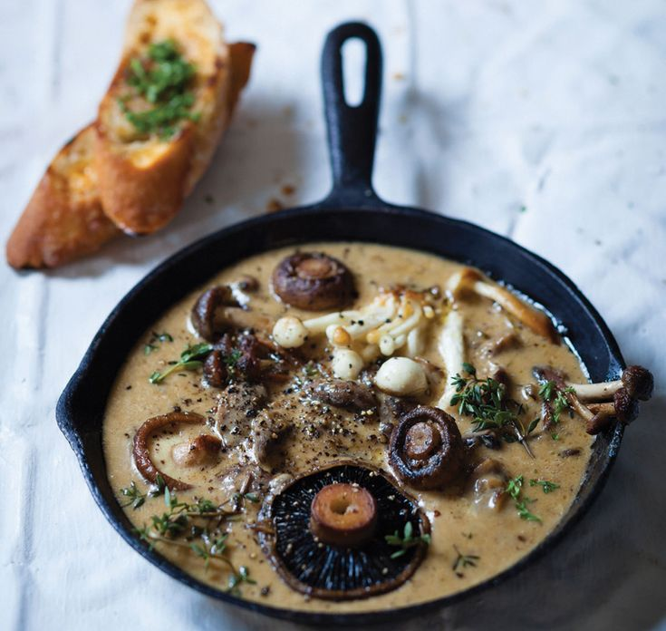 Mushrooms with roasted garlic cream and herb-buttered toast | Woolworths TASTE