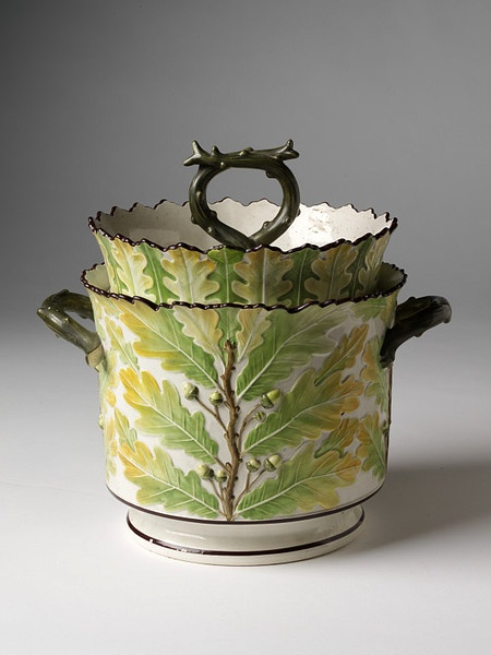 1810 pearlware ice pail by Davenport & Co. Moulded decoration, painted in enamels. The custom of making frozen cream desserts spread from Italy to France, and then to Britain, during the second half of the 17th C. This ice pail and cover is a striking example of early 19th C. naturalism. Unlike many other production lines of the Davenport works, this distinctive type of modelling was particular to the factory. Davenport was one of the big four English ceramic firms during the early-mid 19th…