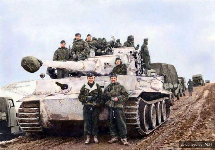Tank ace Otto Carius (left) and Oberfeldwebel Rudolf Zwetti (right) posing in front of (Zweti's) Tiger I of the Schwere Panzer Abteilung 502 on the Eastern Front,end of 1943. Facing the camera, from left to right: Gefreiter Lippmann (radio operator),...