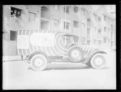 Sun newspaper truck on Dowling St garage in eastern Sydney (year unknown).