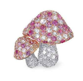 A PINK SAPPHIRE AND DIAMOND BROOCH, BY TIFFANY & CO.  Designed as two mushrooms, each cap pavé-set with circular-cut pink sapphires, accented by brilliant-cut diamonds, joined to the pavé-set brilliant-cut diamond stem, mounted in platinum, 18k yellow and rose gold, 2.2 cm long