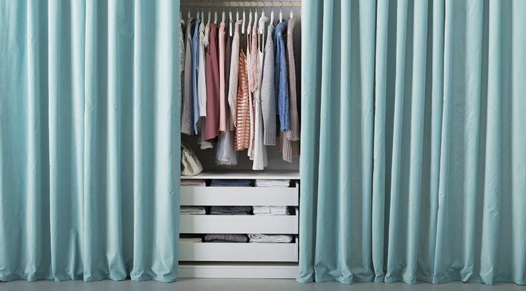 SANELA light turquoise curtains hide clothing storage.