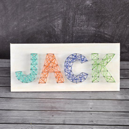 Make your own colorful string letter art with your kiddo's name or a sweet phrase. All you need is a piece of wood, nails, and string!