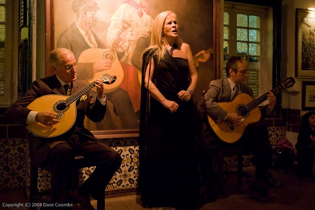 Fado (Portugal). 'Born in a working-class neighbourhood of Lisbon, the melancholic music of fado has been around for centuries. Despite its years, fado remains a living art, heard in tiny mom-and-pop restaurants and  elegant music halls alike. A lone, powerful voice coupled with the 12-string Portuguese guitarra are all the tools needed to bring some listeners to tears.' http://www.lonelyplanet.com/portugal/lisbon