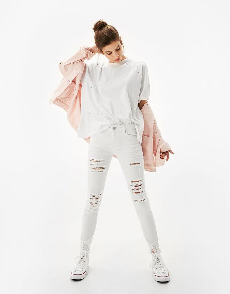 Białe jeansy skinny z rozcięciami - Dżinsy - Bershka Poland