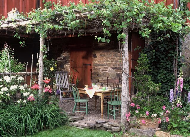 Rustic pergola built beside red barn jon carloftis fine - Small backyard landscape designs ...