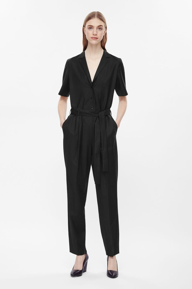 This jumpsuit is made from a soft lightweight wool with a notch lapel v-neckline and a detachable belt. Loosely fitted on the body, it has in-seam pockets, front button fastening and neat press folds.