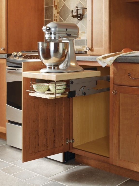 This mixer cabinet by Thomasville Cabinetry frees up counter space while keeping the mixer always within reach. Storage tray below platform also provides additional space for mixer attachments.