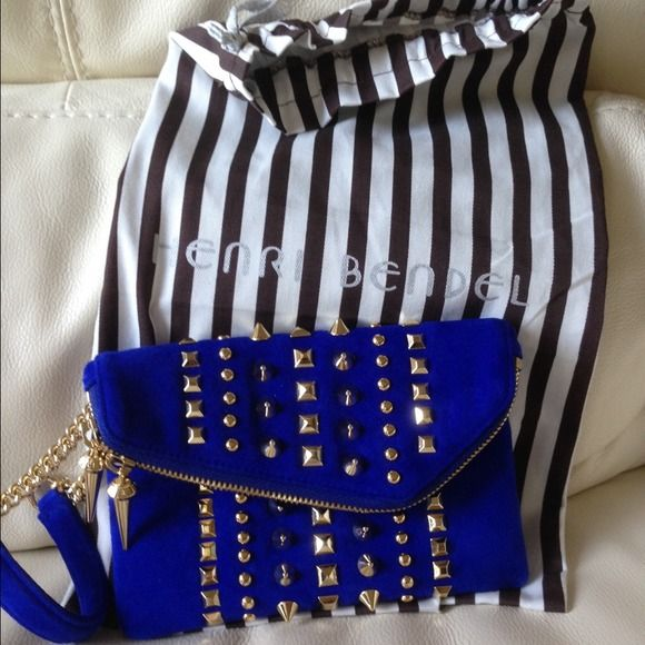 HENRY BENDEL ROYAL BLUE DEB SUPED UP STUDWRISTLET HENRY BENDEL SUPED UP DEB ROYAL BLUE BRUSHED SUEDE GOLD STUDDED CHAIN WRISTLET. MAGNET FRONT FOLD CLOSURE. ZIP GOLD CLOSE FOLD OVER. CHIC! NEW! Henry Bendel Bags
