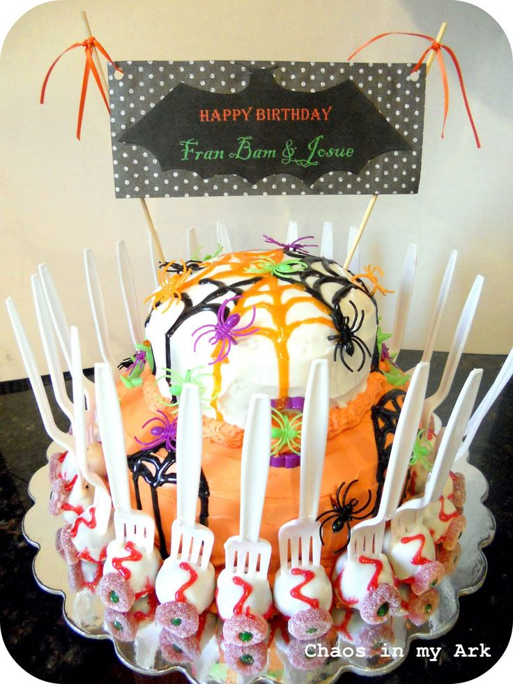 my first halloween cake with cake pop eyeballs on forks