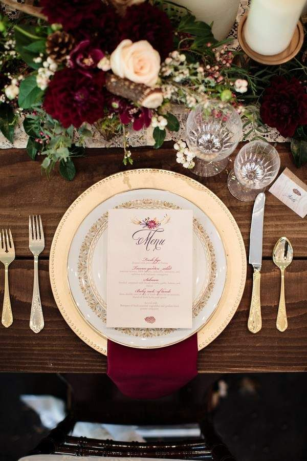 Together the jewel-toned maroon color complements the sassy gold with elegant styling.  And don't forget the rich burgundy dahlias that completed the raw forest look that added a perfectly glam element to the wooden table. @myweddingdotcom