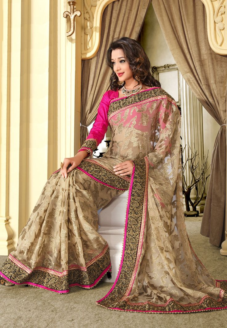 Chiku Color Designer Sraee This Saree Has Heavy Lace Border With Resham Thread Zari Embroidery With Moti Work