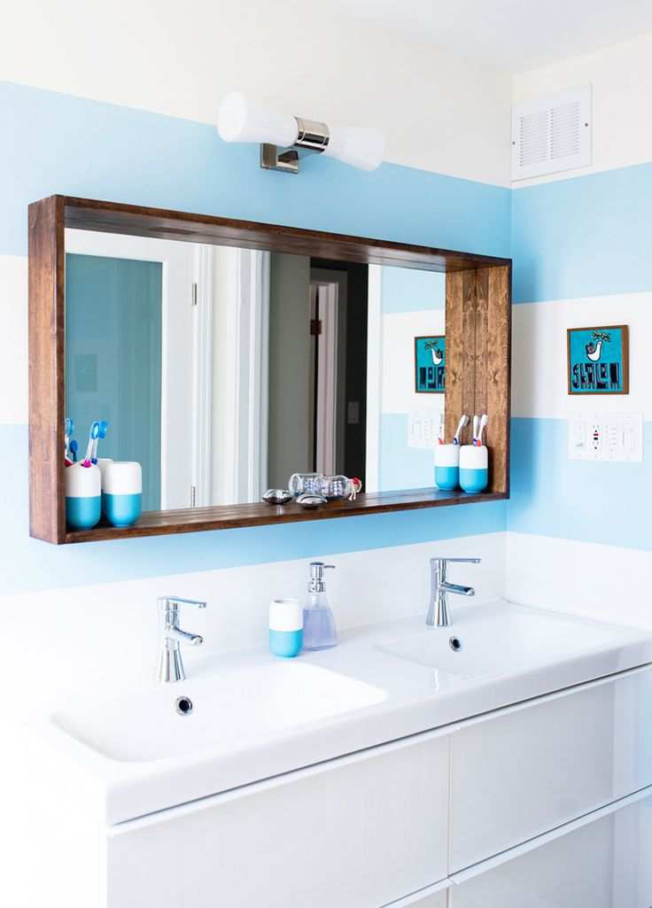 Love this frame around the mirror.  Think we could do this with the bathroom mirror