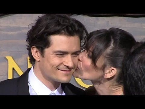 Orlando Bloom Gets A Kiss From Evangeline Lilly At 'The Hobbit' L.A. Pre...