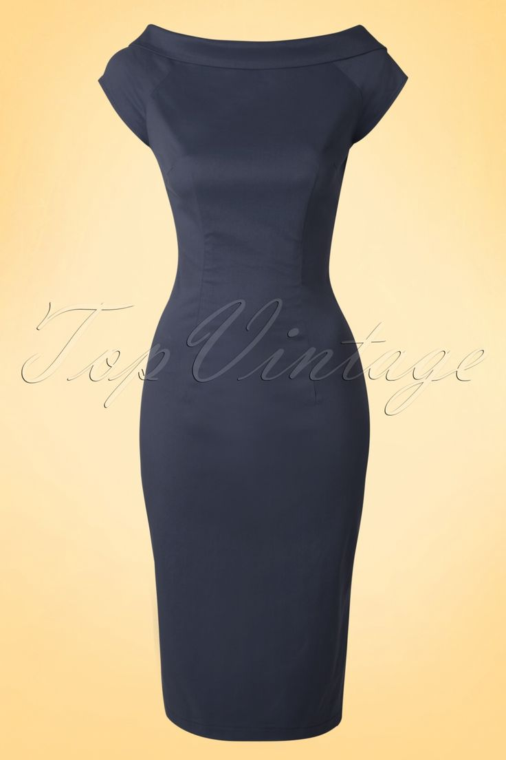 The 50s Cordelia Pencil Dress is an elegant dress with a little surprise at the back!  This beauty is the perfect mix of a classic style with the elegance of the 50s, très chique! Beautiful boat neck with fold-over collar which ends in a low cut with cute fixed bow at the back. Made from a stretchy grey blue cotton blend which hugs your curves in all the right ways. Put on your favourite pumps, add a pearl and you're good to go ;-)    Cap sleeves Sexy slit at the back Hidden...