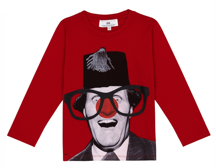 A red long sleeved T-shirt featuring a striking black and white photograph of legendary British comedian Tommy Cooper, with the addition of a red nose and glasses.  Designed by Stella McCartney exclusively for Red Nose Day. With at least £2.50 going to Comic Relief, helping to change lives across the UK and Africa, t-shirt £6.99.    £2.50 could provide one night's shelter for a woman in Uganda who has fled domestic abuse. 100% organic Fairtrade certified cotton. Wash at 40.