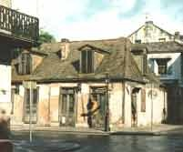 """One of the all-time favorite tourist attractions of the New Orleans French Quarter is Jean Lafitte's Blacksmith Shop, on the corner of Bourbon Street and St. Phillip Street. It was built sometime before 1772, and is one of the few remaining original """"French architecture"""" structures in the French Quarter."""