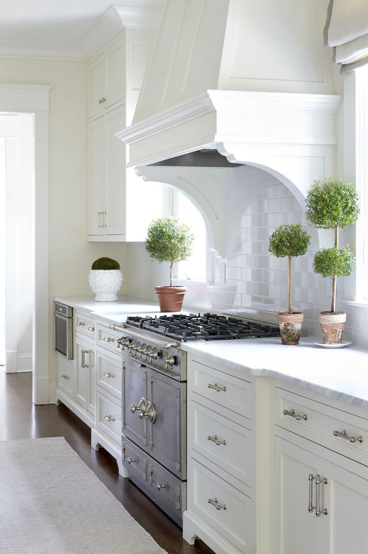 The Highlands – Sarah Bartholomew | classic white kitchen. Love the myrtle topiaries!