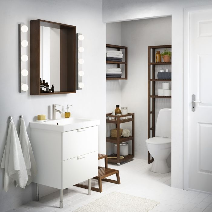 MOLGER bathroom furniture stands out and makes a statement in a white bathroom.