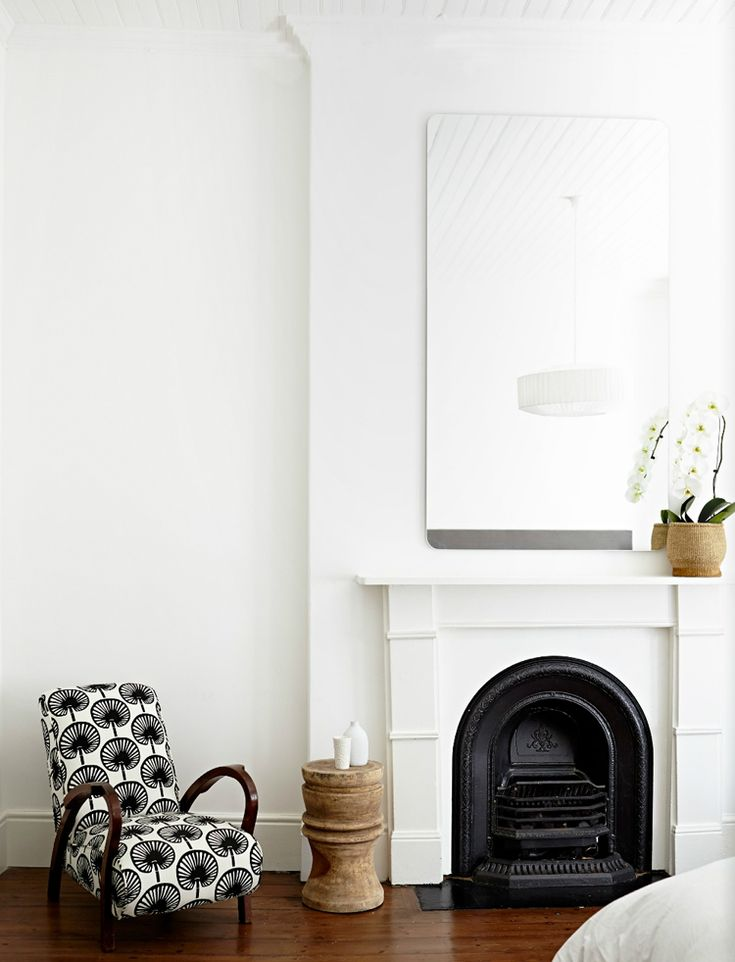 patterned chair and white global living room via @citysage