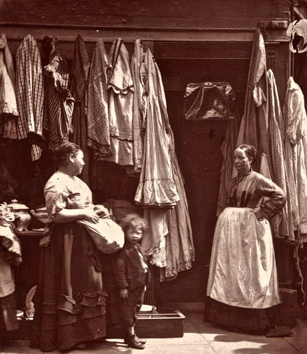 """An Old Clothes Shop, St Giles - """"As a rule, secondhand clothes shops are far from distinguished in their cleanliness, and are often the fruitful medium for the propagation of fever, smallpox """""""