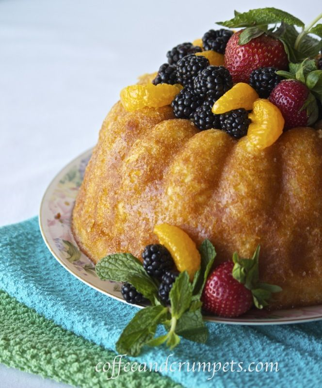 Orange Savarin: a rich, yeasted cake soaked with orange scented syrup, filled with cream and assorted fruit.