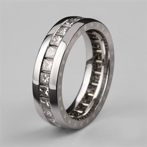 Geo Elipse men's eternity ring. You see ladies the thing is why should you be the only ones wearing an eternity ring? We have men's engagement rings and now we have a mans eternity ring too. So come on all you people who have been together for years, celebrate with this exquisite ring. This engineered design is made with two bands which are riveted together to hold the square cut tension set precious stones in place. It's a tough yet refined eternity ring, handmade in our London workshops.