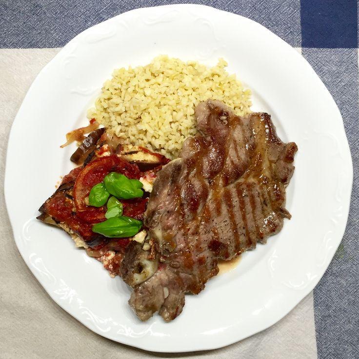 Greek style dinner II • Grilled pork neck • bulgur • Baked aubergine with feta cheese, tomatoes, onion, oregano and cinnamon