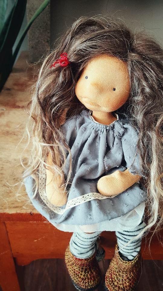 Lil' Chickpea doll wearing a pretty Swiss cotton dress
