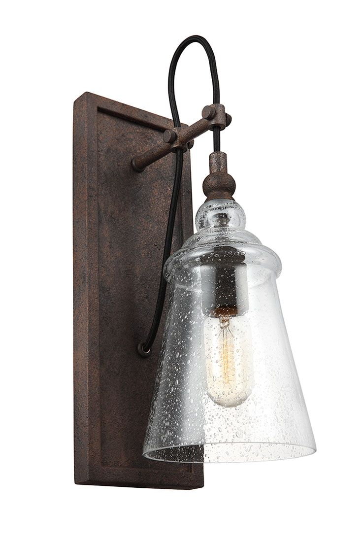 Loras 1 - Light Wall Sconce by Feiss: Is a contemporary take on historic, industrial designs. Clear Seeded glass shades add more rustic charm to this vintage-inspired silhouette. In a dark Weathered Iron Finish. Through the clear glass shades, the exposed bulbs are central to the design theme, so Edison-style bulbs are a perfect choice. Perfect for rustic, traditional inspired décor.