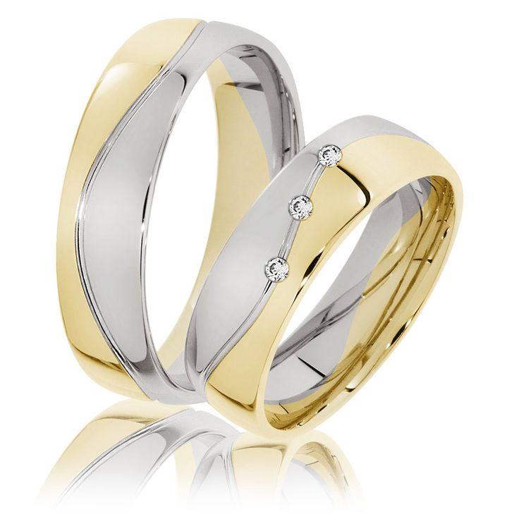 Trauringe Freising aus zweifarbigem 333er Gold. Gelbgold und Weißgold vereint mit 3 funkelnden Brillanten. Sehr beliebtes Modell bei den Brautpaaren.