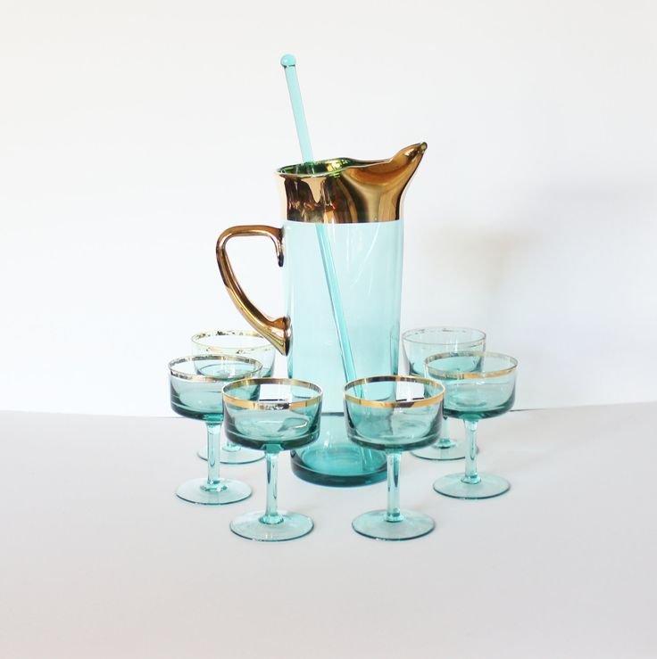 Vintage 50s GREEN Gold Ring Set of Six Glasses and Pitcher with Stir Stick. $52.00, via Etsy.