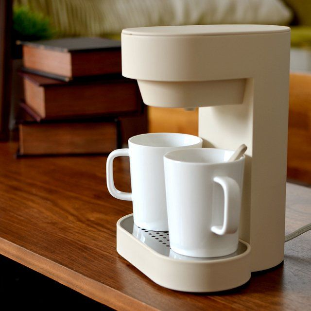 Prepare two cups of steaming coffee simultaneously for you and your friend anytime during the day using this 2-Cup Coffee Maker by PlusMinusZero. I