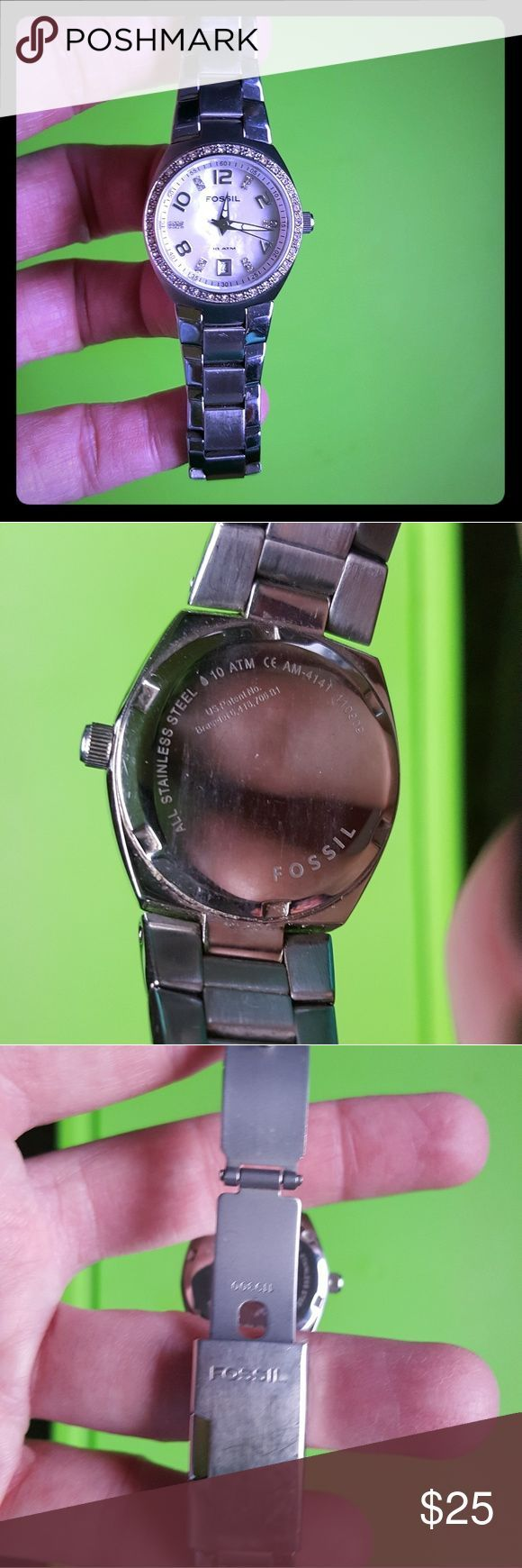 Women's Fossil watch Silver Fossil watch with rhinestones around the face. Pearl color background. Scratches on clasp from wear. Needs battery. Loved condition. Fossil Accessories Watches