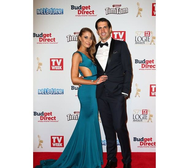 Andy Lee and Rebecca Harding wearing a fabulous jewel toned gown