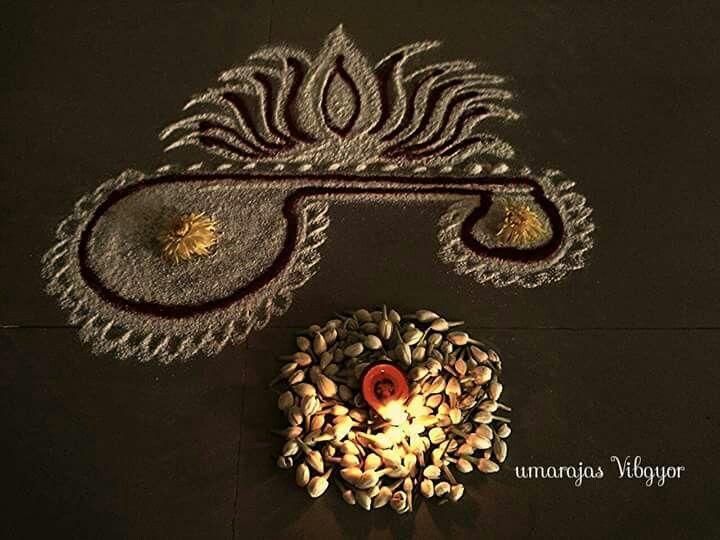 Beautiful rangoli ...veena & lotus by Umarajas vibgyor
