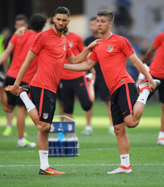 Luciano Vietto Photos - Yannick Carrasco and Luciano Vietto of Atletico Madrid during an Atletico de Madrid training session on the eve of the UEFA Champions League Final against Real Madrid at Stadio Giuseppe Meazza on May 27, 2016 in Milan, Italy. - Previews - UEFA Champions League Final