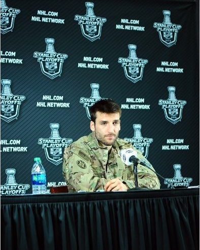 Why the NHL Playoffs are better than the NBA Playoffs these days, Part 1: hockey players don't wear stupid fake nerd glasses during post-game press conferences, but instead wear cool outfits like military uniforms. Suck on that, wannabe hipster jokes of today's NBA!