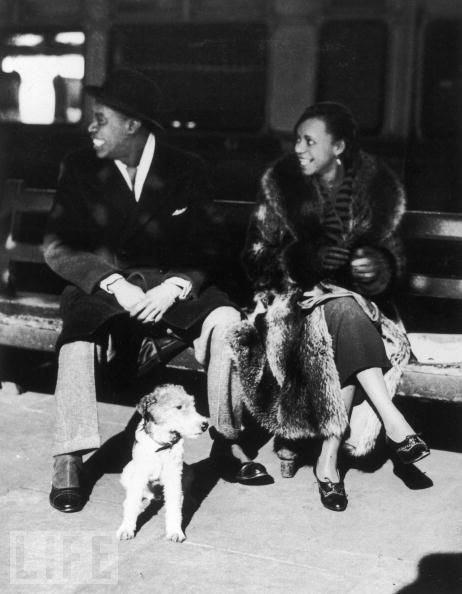 Louis Armstrong And Alpha Smith With Dog ( a lovely wire fox terrier!), England, 1933.