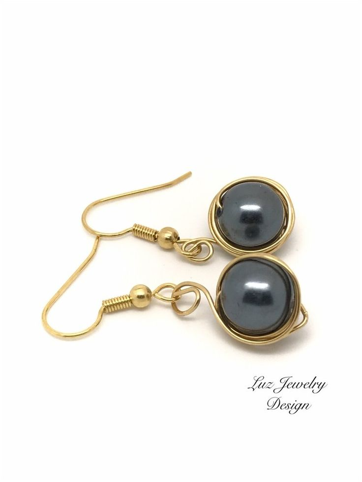 These unique earrings are made with black glass pearl with a gold cup. Measure: 1 inch *Packaging Your black earrings will be packed in a gift box. Because all of the piece in this shop are handcrafte