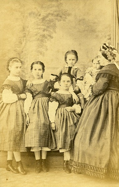 http://www.flyingpioneers.com/boop/pixlg/a00319.jpg A whole range of ages with shorter skirts, back fastening dresses, and short sleeves