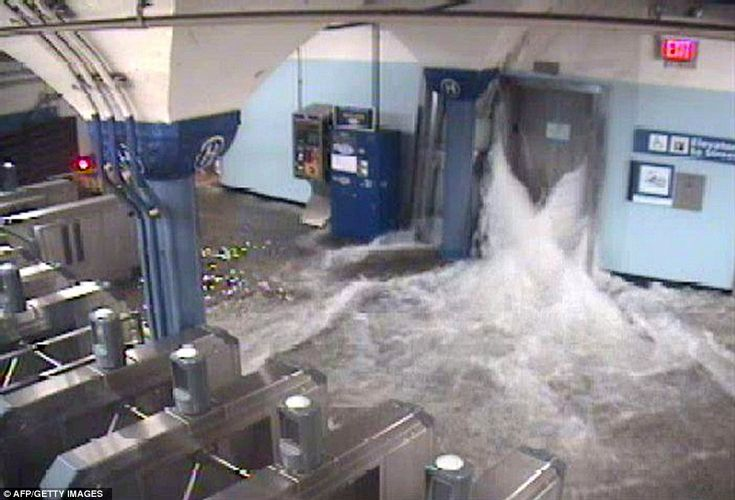 This CCTV photo shows flood waters from Hurricane Sandy rushing in to the Hoboken PATH train station through an elevator shaft in New Jersey