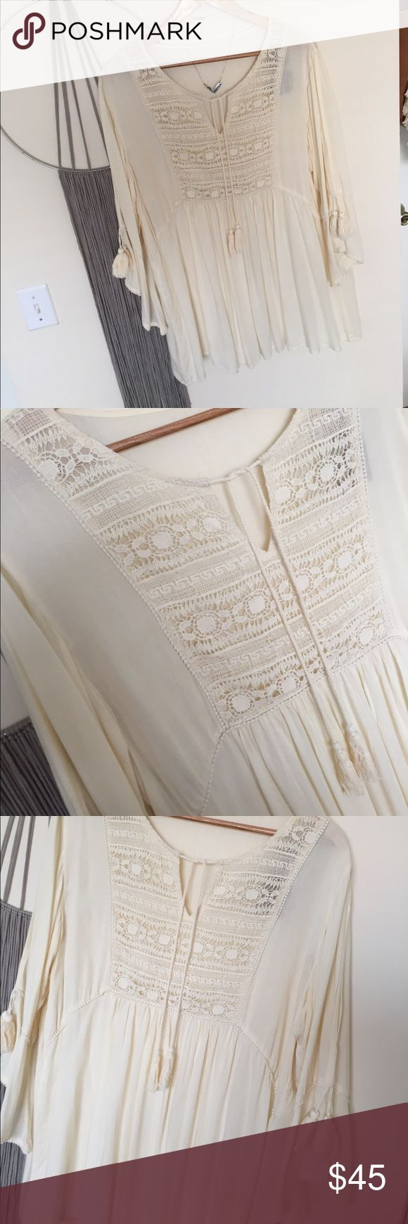 Sacred Threads Boho Tunic Top ✌🏽🌈 NWT Sacred Threads Boho/Festival Tunic Top. Cream color oversized style w/crochet & fringe detailing. Flare flutter sleeves w/upper arm openings. Can be a mini dress on someone petite 5'2 under or as a really lovely top for taller height. Brand new, never worn. Would be adorable dressed up or just as casual wear, very versatile. N🚫 Trades. ☀️🏄🏽♀️🌴 ps keep in mind juniors sizing runs smaller. Sacred Threads Tops Tunics