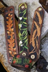 Oak leaf and yew! Perfect for representing boys. range of hand carved leather wristbands