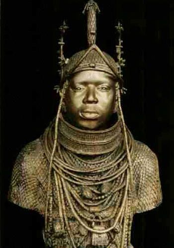 The Oba is the sacred king who controlled the empire of Benin.   The sculpture shows him wearing the costume the Oba wears in processions and ceremonies. The headdress has coral beads and the cross-hatching that I noticed on the sculpture is actually a cloth that is woven by his weavers and is embellished with various regal motifs
