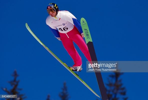 The Norwegian skier leaps to victory at the Winter Olympics