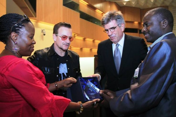 A Tanzanian forum that gives small holder farmers a voice in lobbying for better agricultural policies has won the 2013 ONE Africa Award today.  Audax Rukonge from ANSAF receives the $100,000 prize from Bono, ONE Africa Director Dr. Sipho Moyo, and Chairman of the ONE Board Tom Freston at the ceremony in Addis Ababa, Ethiopia. #u2NewsActualite #u2NewsActualitePinterest #bono #PaulHewson #U2 #music #rock  http://the-angel-of-harlem.tumblr.com/