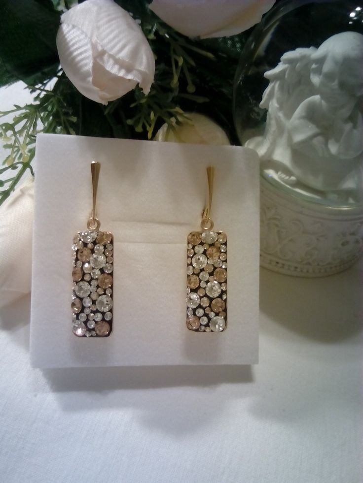 Gold plated silver earrings with crystal and golden shadow Swarovski crystals.