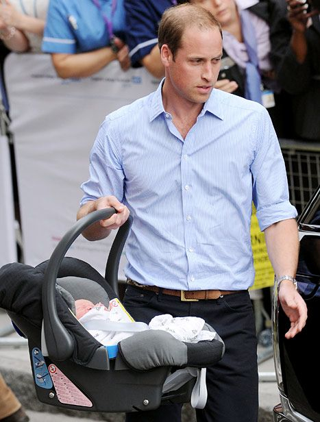 Prince William carrying the Prince of Cambridge in his Britax car seat