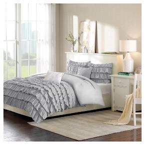 Make your bedroom perfectly pretty with the Marley Ruffle Comforter Set. This lovely blue or white comforter set includes a comforter, 2 decorative pillows and 1 sham. The sham and comforter have a gorgeous, multi-layered ruffled pattern, 1 decorative pillow has gathered fabric in a striped arrangement, and the other decorative pillow is white with a simple, abstract flower pattern. Available in twin and full/queen sizes. Fabric and fill: 100% polyester.